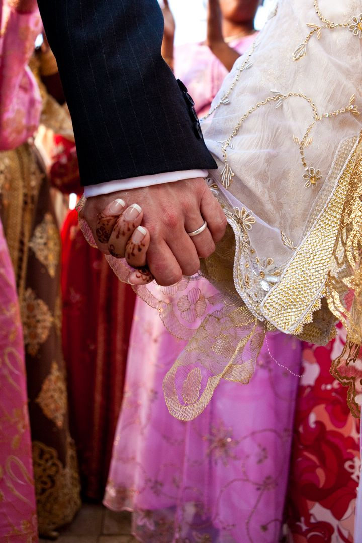 The author decided to act when she realised many Muslim women were lacking practical advice on how to enjoy their married sex lives (file picture of a couple getting married in Morocco)