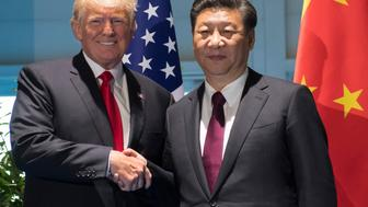 US President Donald Trump and Chinese President Xi Jinping (R) shake hands prior to a meeting on the sidelines of the G20 Summit in Hamburg, Germany, July 8, 2017. / AFP PHOTO / POOL / SAUL LOEB        (Photo credit should read SAUL LOEB/AFP/Getty Images)