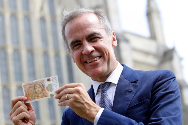 Bank of England Governor Mark Carney holds the new note, unveiled at Winchester Cathedral, Jane Austen'sresting...