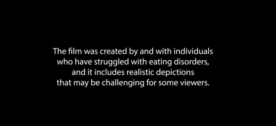 "Trigger warning displayed before ""To The Bone,"" a movie about a young woman getting treatment for an eating disorder."