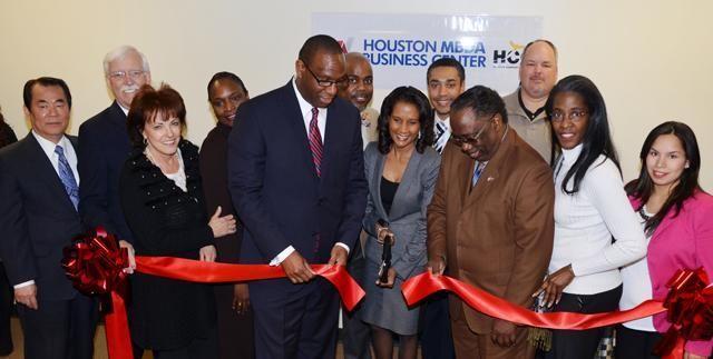 Helen Callier, Bradlink President in white shirt celebrating the opening of Houston MBDA Center.
