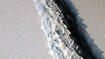 An oblique view of a massive rift in the Antarctic Peninsula's Larsen C ice shelf is shown in this November 10, 2016 photo taken by scientists on NASA's IceBridge mission in Antarctica.  Courtesy John Sonntag/NASA/Handout via REUTERS    ATTENTION EDITORS - THIS IMAGE WAS PROVIDED BY A THIRD PARTY. EDITORIAL USE ONLY.