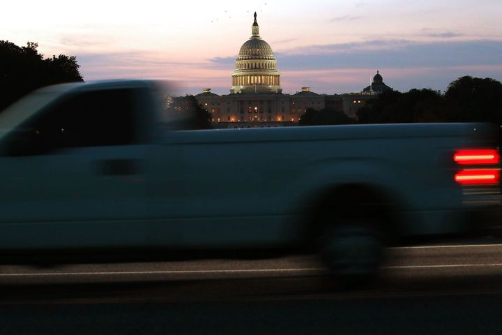 The sun begins to rise behind the U.S. Capitol on Tuesday.
