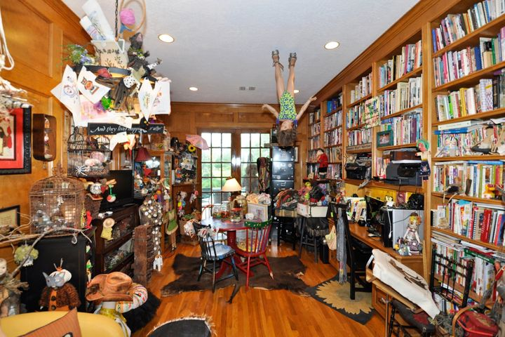 Reading or crafts room, with mannequin hanging from the ceiling.