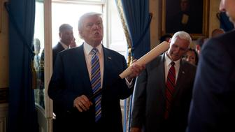 WASHINGTON, DC - JULY 17:  (AFP OUT) U.S. President Donald Trump holds a baseball bat while participating in a Made in America event with companies from 50 states featuring their products in the Blue Room of the White House July 17, 2017 in Washington, DC. American manufacturers representing each of the 50 states participated in the showcase, including Bully Tools, Cheerwine, Stetson, Simms and RMA Armament, Charles Machine Works, Honckley Yachts, Altec Inc., Caterpiller, Pierce Manufacturing and others.  (Photo by Andrew Harrer-Pool/Getty Images)