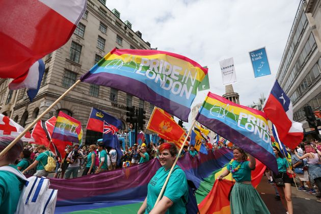 People take part in the Pride in London Parade in central