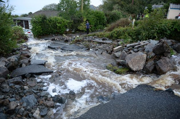 A driveway is lifted caused by water from flash flooding in the coastal village of Coverack in