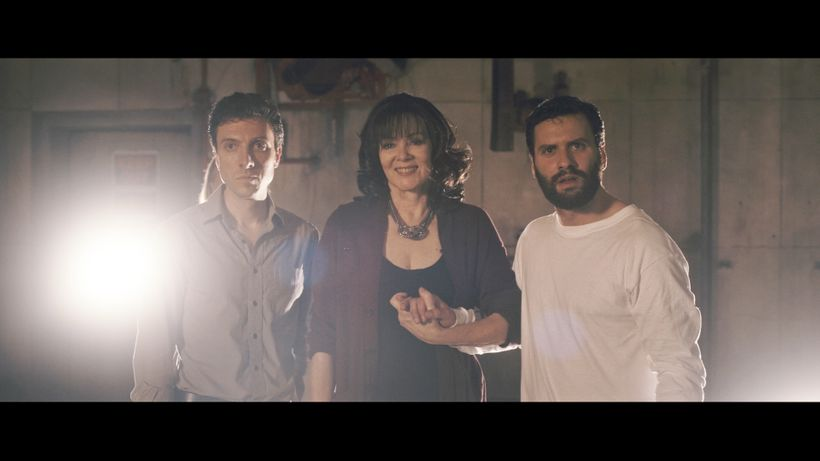 Jake (left) and Adam with their beaming Mom Evette in <em>Shadowman</em>.