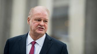 UNITED STATES - MARCH 18: Arizona Attorney General Tom Horne speaks to the media following the Supreme Court oral arguments in the Arizona v. Inter Tribal Council of Arizona case on Monday, March 18, 2013. The case revolves around the Proposition 200, passed in 2004 by voters, which requires Arizona residents to provide proof of citizenship when registering to vote. (Photo By Bill Clark/CQ Roll Call)