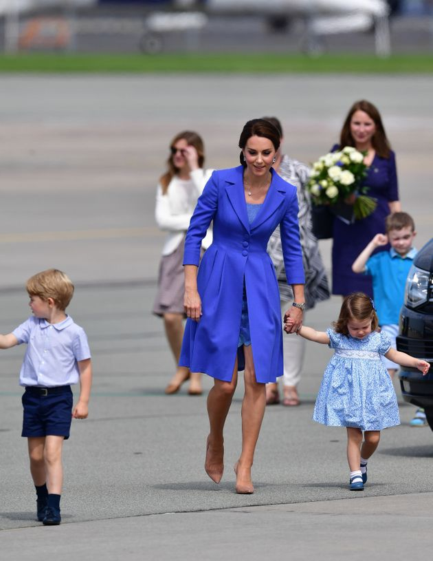 The Duchess Of Cambridge Wears Royal Blue As She Heads To