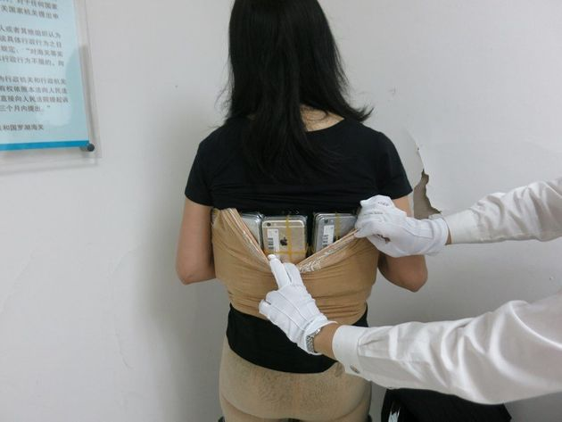 This woman was caught smuggling over 100 iPhones into the country