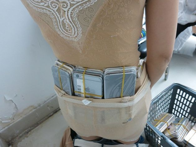 Woman Caught Smuggling 102 iPhones Into China
