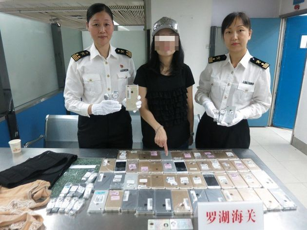 Woman caught smuggling 40-pound suit made of iPhones