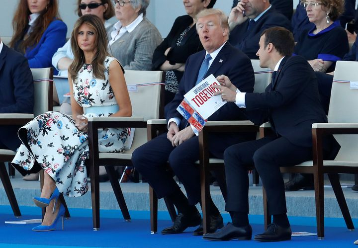 President Macron, President Trump and First Lady Trump attend the 2017 Bastille Day military parade.