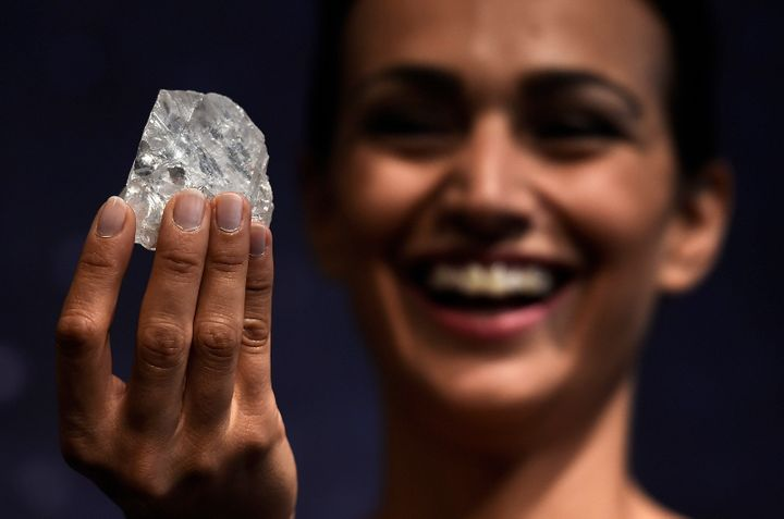 "A model shows off the 1109 carat ""Lesedi La Rona"", the largest gem quality rough diamond discovered in over 100 years during a sale preview at Sotheby's auction house in London, Britain, June 14, 2016"