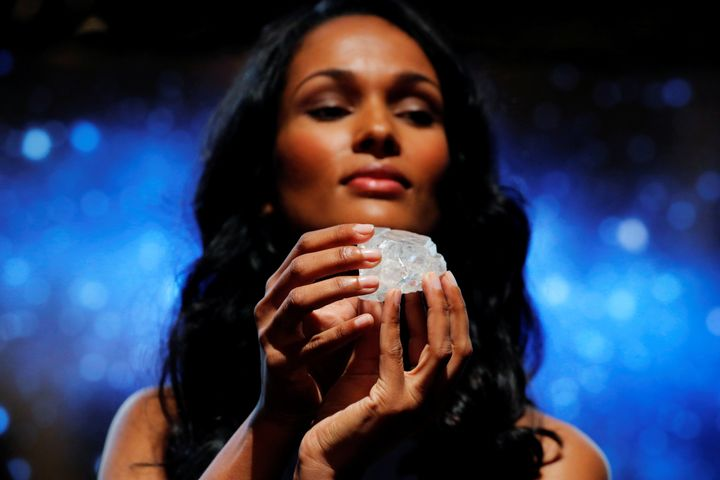 "A model displays the 1109 carat ""Lesedi La Rona"" diamond at Sotheby's in the Manhattan borough of New York, U.S., May 4, 2016."
