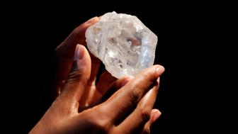 """A model displays the 1109 carat """"Lesedi La Rona"""" diamond at Sotheby's in the Manhattan borough of New York, U.S., May 4, 2016. REUTERS/Lucas Jackson"""