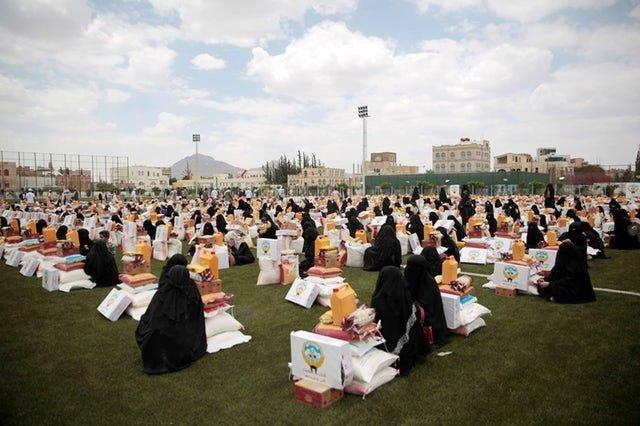 Women collect aid in Sanaa, Yemen, last month.
