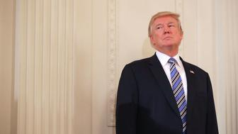 WASHINGTON, DC - JULY 17:  U.S. President Donald Trump waits to take the stage during a Made in America product showcase in the East Room of the White House July 17, 2017 in Washington, DC. American manufacturers representing each of the 50 states participated in the showcase, including Bully Tools, Cheerwine, Stetson, Simms and RMA Armament, Charles Machine Works, Honckley Yachts, Altec Inc., Caterpiller, Pierce Manufacturing and others.  (Photo by Chip Somodevilla/Getty Images)