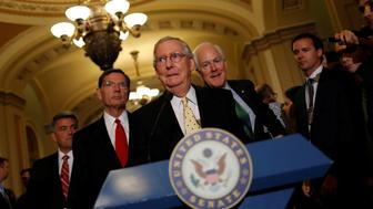 U.S. Senate Majority Leader Mitch McConnell, accompanied by Senator Cory Gardner (R-CO), Senator John Barrasso (R-WY) and Senator John Cornyn (R-TX), arrives to speak with the media about the recently withdrawn healthcare bill on Capitol Hill in Washington, U.S., July 18, 2017. REUTERS/Aaron P. Bernstein