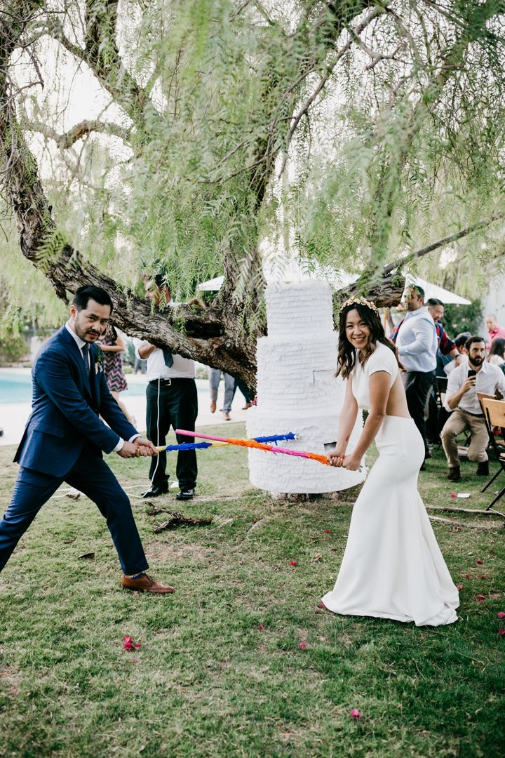The bride and groom had their game faces on when they tied the knot at La Chureya Estate in Palm Springs.