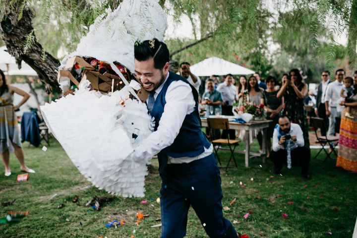 The groom ended up tackling the piñata to get all the goodies out.