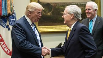 US President Donald Trump shakes hands with Senate Majority Leader Mitch McConnell as he meets with Republican congressional leaders in the Roosevelt Room at the White House in Washington, DC, on June 6, 2017. / AFP PHOTO / NICHOLAS KAMM        (Photo credit should read NICHOLAS KAMM/AFP/Getty Images)