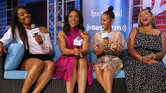 NEW ORLEANS, LA - JUNE 30: (Left to Right) The cast of the movie Girls Trip, Tiffany Haddish, Regina Hall, Jada Pinkett Smith and Queen Latifah speak during the Essence Music Festival at the Ernest N. Morial Convention Center on June 30, 2017 in New Orleans, Louisiana.  (Photo by Jonathan Bachman/Getty Images for Universal)