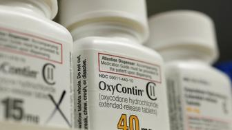 Bottles of prescription painkiller OxyContin, 40mg pills, made by Purdue Pharma L.D. sit on a shelf at a local pharmacy, in Provo, Utah, U.S., April 25, 2017. REUTERS/George Frey