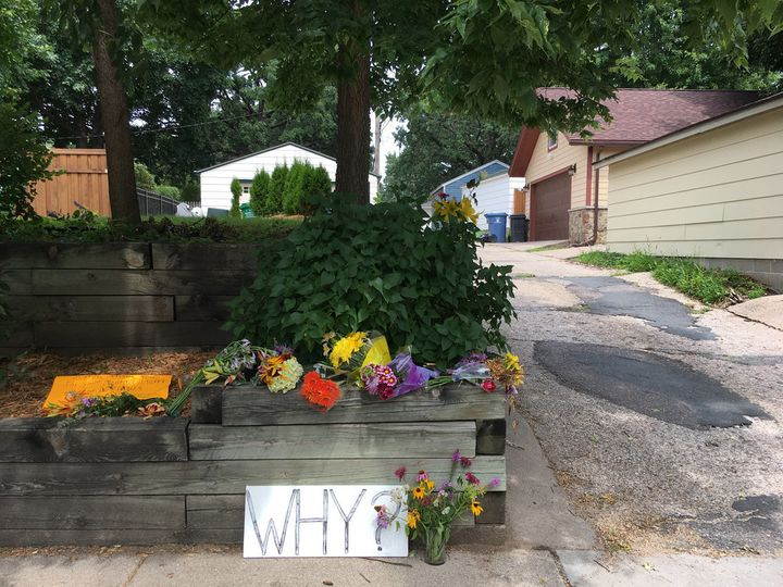 "On Wednesday, flowers and a sign that reads, ""Why?"" were found near an alley where Justine Damond was fatally shot."