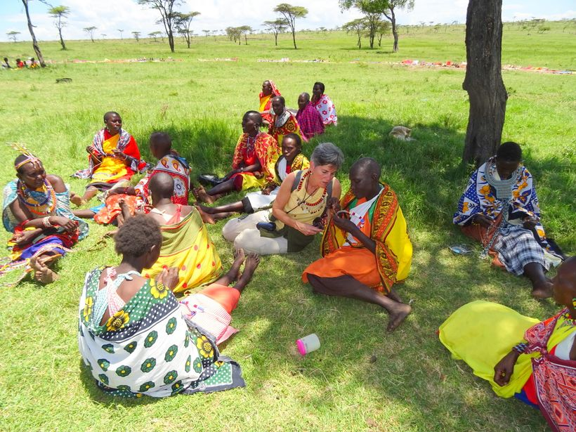 <em>Getting a primer on a more complicated project with women making and selling beads in Maasai Mara</em>