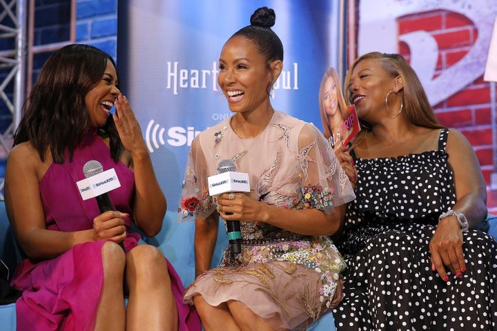"""Girls Trip"" stars Regina Hall, left, Jada Pinkett Smith, center, and Queen Latifah speak during the Essence Music Festival."