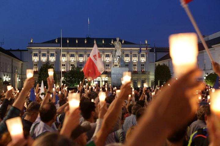 Protesters gather in front of the Presidential Palace during a peaceful protest against the judicial reforms in Warsaw, Polan