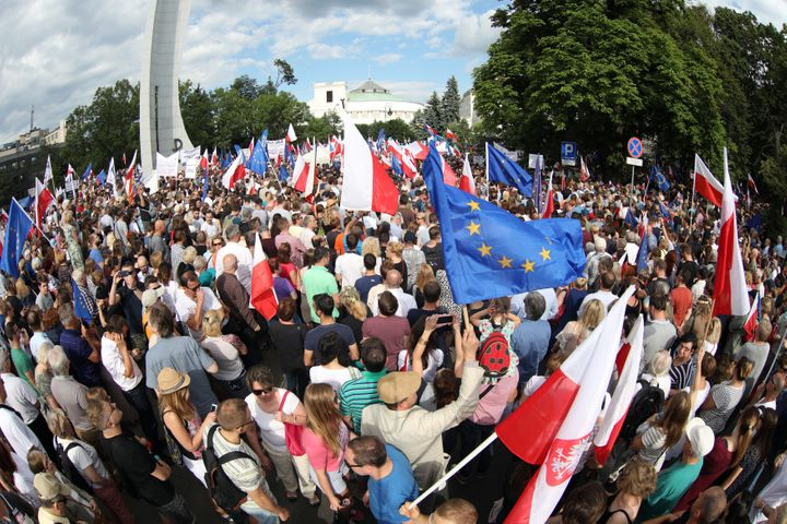 Protesters gather Tuesday in front of the Parliament building during an opposition protest in Warsaw, Poland.