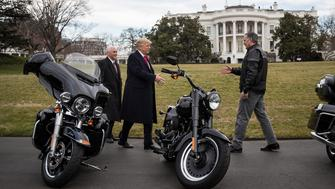 U.S. President Donald Trump, center, greets Matthew Levatich, chief executive officer of Harley-Davidson Inc., right, as U.S. Vice President Mike Pence, smiles, outside of the White House in Washington, D.C., U.S., on Feb. 2, 2017. Trump continued to court his pro-manufacturing base with yet another summit involving a chief executive officer, greeting Harley-Davidson Inc. executives and union officials to the White House on Thursday. Photographer: Drew Angerer/Pool via Bloomberg