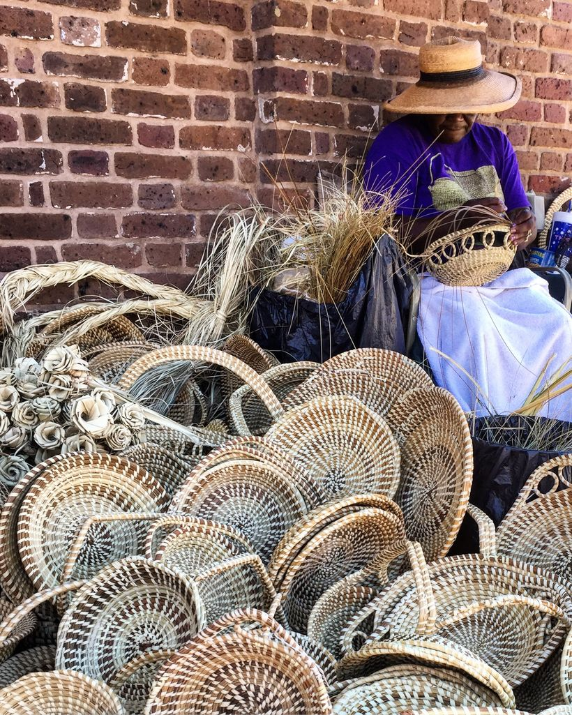 "Enslaved Africans in Charleston created their own language and culture, called ""gullah.""  Sweetgrass baskets made in the same"