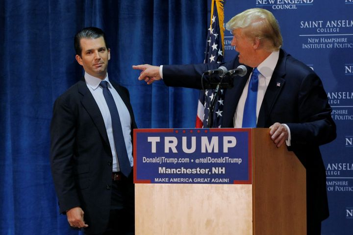 Then-presidential candidate Donald Trump welcomes his son, Donald Trump Jr., to the stage at one of the New England Council's
