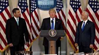 U.S. President Donald Trump, center, speaks as Vice President Mike Pence, right, and Kris Kobach, Kansass secretary of state, listen during the initial meeting of the Presidential Advisory Commission on Election Integrity at the Eisenhower Executive Office Building in Washington, D.C., U.S., on Wednesday, July 19, 2017. President Trump created the advisory commission in May, after claiming without evidence that 3 million people or more illegally voted for Hillary Clinton last year. Photographer: Andrew Harrer/Bloomberg via Getty Images