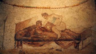 Picture taken 26 October 2006 of an erotic frescoe in Pompeii�s Lupanare site. Art officials present a newly-restored ancient brothel in the archaeological complex of Pompeii, believed to be the most popular one in the ancient Roman city. AFP PHOTO / MARIO LAPORTA (Photo credit should read MARIO LAPORTA/AFP/Getty Images)