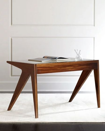 "<a href=""http://www.horchow.com/"" target=""_blank"">Horchow</a> specializes in high-end furniture and design solutions, <a href"