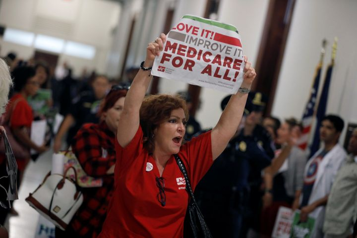 A health care activist affiliated with the National Nurses United labor union protests the Republican health care bill on Wed