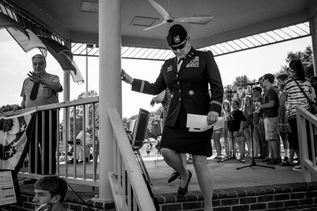 Lt. Col. Alicia Masson, the former commander of the Army base in Radford, exits the stage after giving...