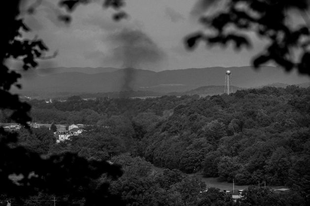 A cloud of smoke rises as the Radford Army Ammunition Plant in southwest Virginia conducts...