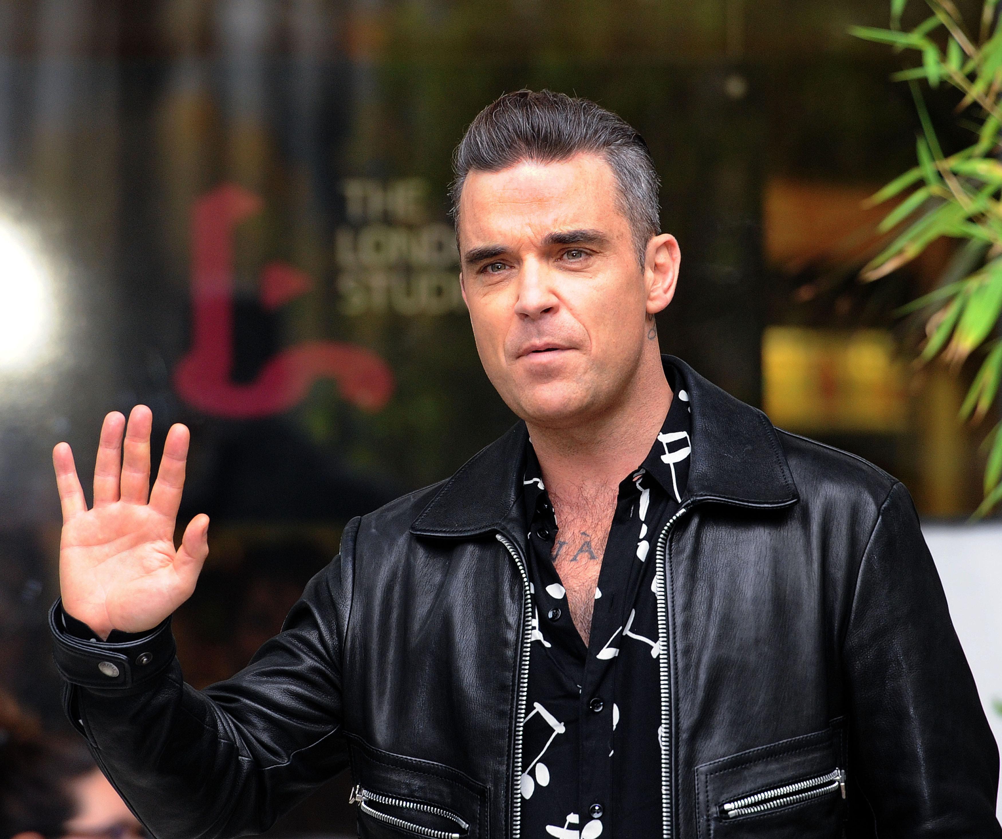 Robbie Williams Reveals He Eats During His Sleep Due To Rare