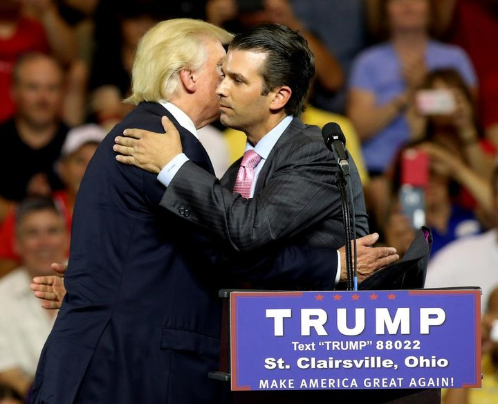 Then-candidate Donald Trump hugs his son Donald Trump Jr. at a campaign rally in 2016.