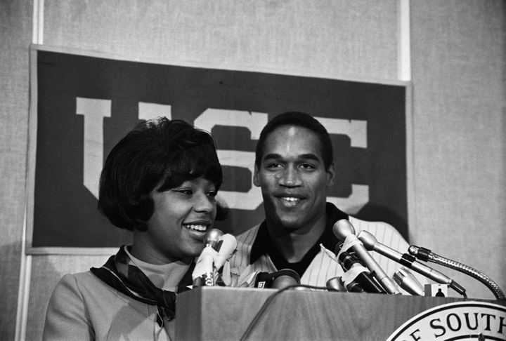 O.J. Simpson and his first wife, Marguerite, smile happily at a press conference after he was named winner of the 1968 Heisma