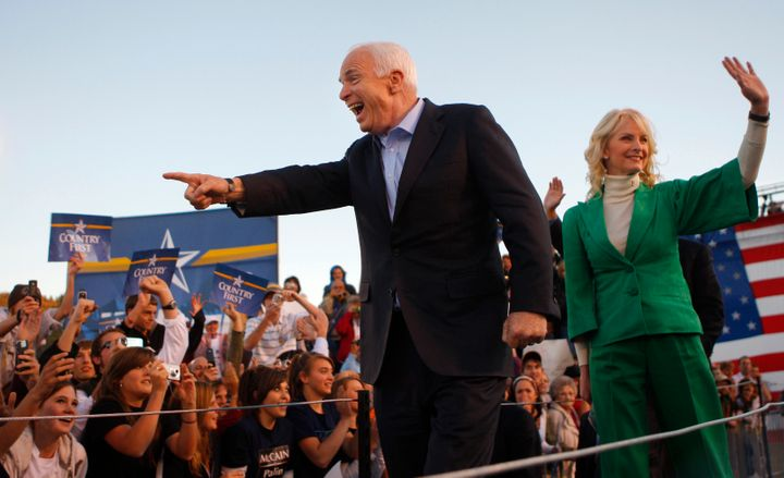 Republican presidential nominee John McCain, left, and his wife, Cindy, arrive at a campaign rally in Durango, Colorado, in O