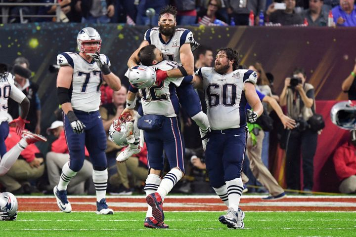 Julian Edelman is pictured celebrating the New England Patriots' win over the Atlanta Falcons with his teammates at Super Bow
