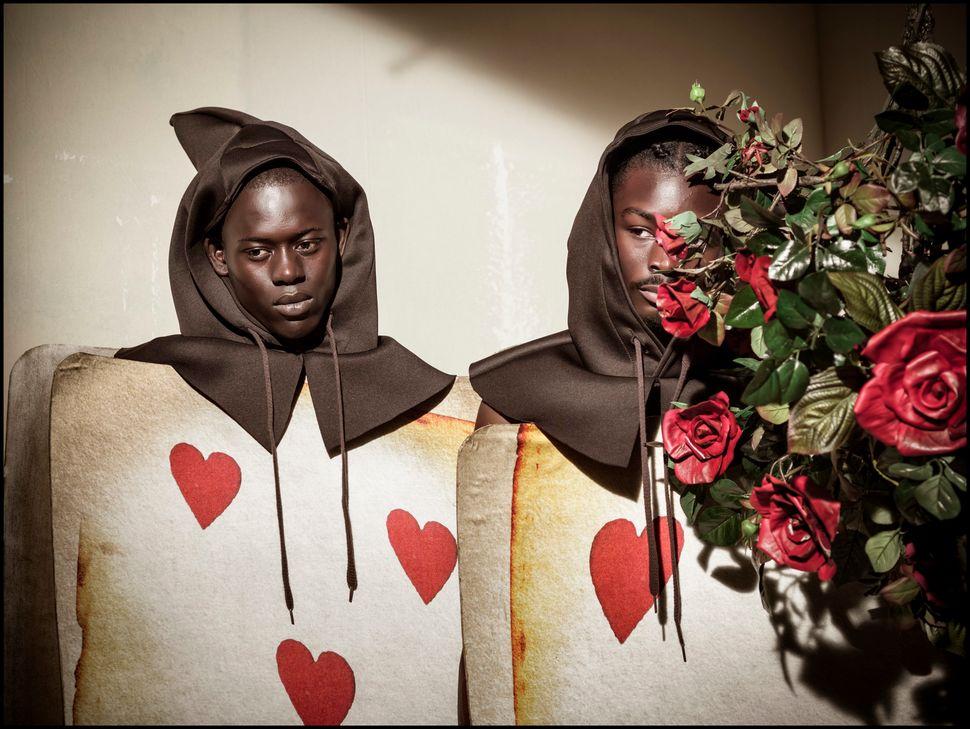 Alpha Dia asthe Five-Of-Hearts-Playing-Card Gardener and King Owusu asthe Two-Of-Hearts-Playing-Card Gardener.