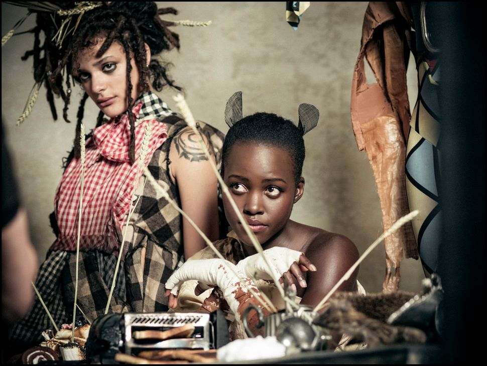 Sasha Lane as the Mad March Hareand Lupita Nyong'o as the Dormouse.